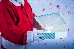 圣诞老人开头礼物盒的综合图象 免版税库存图片