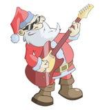 圣诞老人弹吉他 免版税库存图片