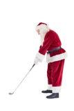 圣诞老人打高尔夫球 免版税库存照片