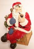 圣诞老人抽烟 免版税图库摄影