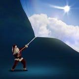 圣诞老人拉扯与天天空的横幅 免版税库存照片