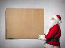 圣诞老人拿着大礼物盒 库存照片