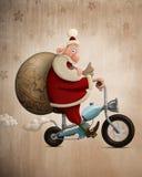 圣诞老人摩托车交付 库存照片