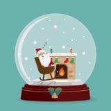 圣诞老人放松在雪地球的壁炉 免版税图库摄影