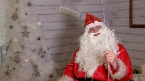 圣诞老人显示与一个不可思议的球的焦点 库存图片
