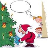 圣诞老人暗中侦察 免版税库存图片