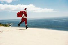 圣诞老人最后得到他的假期! 免版税库存照片
