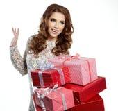 圣诞老人有礼物盒的辅助工女孩 库存照片