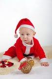 圣诞老人有装饰品的圣诞节婴孩 免版税图库摄影