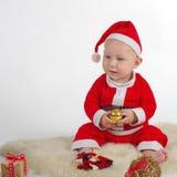 圣诞老人有装饰品的2圣诞节婴孩 库存照片