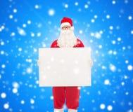 圣诞老人服装的人有广告牌的 免版税库存照片