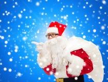 圣诞老人服装的人有袋子的 库存照片
