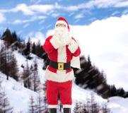 圣诞老人服装的人有袋子的 图库摄影