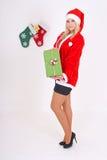 圣诞老人服装的妇女与礼品 免版税库存图片