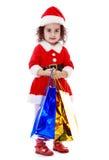 圣诞老人服装的小女孩  免版税库存图片
