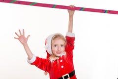 圣诞老人服装的小女孩 图库摄影