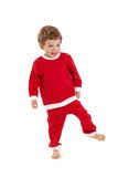 圣诞老人服装的愉快的小男孩 库存照片