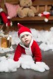 圣诞老人服装的男婴 圣诞节 新年度 免版税库存照片