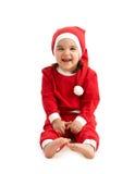 圣诞老人服装的笑的小女孩 免版税库存图片