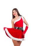 圣诞老人服装的美丽的女孩 免版税库存照片