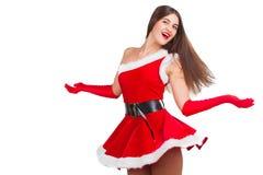 圣诞老人服装的美丽的女孩 库存照片