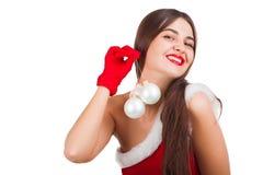 圣诞老人服装的美丽的女孩 免版税图库摄影