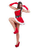 圣诞老人服装的美丽的女孩 库存图片