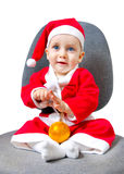 圣诞老人服装的美丽的婴孩  免版税库存图片