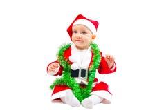 圣诞老人服装的婴孩坐 库存图片