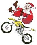 圣诞老人极端摩托车越野赛 库存图片
