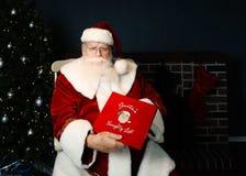 圣诞老人淘气名单 免版税库存图片