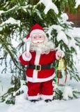 圣诞老人玩偶在树下 免版税库存照片