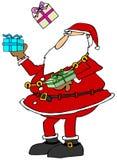 圣诞老人玩杂耍的包裹 免版税库存照片
