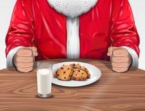 圣诞老人用曲奇饼和牛奶 库存图片