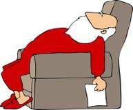 圣诞老人疲倦了 免版税库存照片