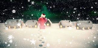 圣诞老人的综合图象在一只手上拿着他的袋子 免版税图库摄影