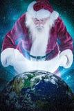 圣诞老人的综合图象在他的袋子看 库存图片