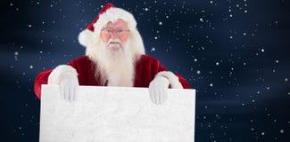 圣诞老人的综合图象拿着一个标志 免版税图库摄影