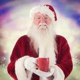 圣诞老人的综合图象拿着一个红色杯子 库存图片