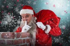 圣诞老人的综合图象有手指的在站立在烟囱旁边的嘴唇 免版税库存照片