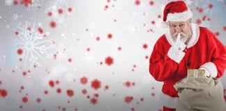 圣诞老人的综合图象有手指的在嘴唇和举行礼物 库存照片