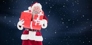 圣诞老人的综合图象运载一些个礼物 库存照片
