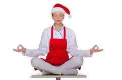 圣诞老人盖帽的厨师  库存照片