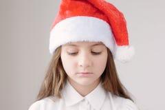 圣诞老人盖帽的小梦中情人 库存图片
