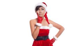 圣诞老人看对边想法愉快和pla的圣诞节妇女 库存图片
