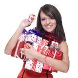 圣诞老人礼服的妇女与礼品 库存图片