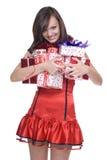 圣诞老人礼服的妇女有礼品的 免版税库存图片