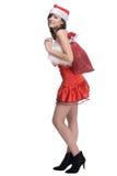圣诞老人礼服的妇女有袋子的 免版税库存照片