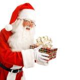 圣诞老人秘密地带来了礼物 免版税库存图片
