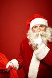圣诞老人秘密  免版税库存照片